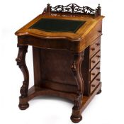 A VICTORIAN WALNUT DAVENPORT with fret carved gallery, green leather inset fall front, a satinwood