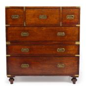 A MID TO LATE 19TH CENTURY CAMPAIGN CHEST with central secretaire drawer, two short drawers and