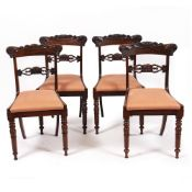 A SET OF FOUR WILLIAM IV ROSEWOOD BAR BACKED DINING CHAIRS with upholstered inset seats and turned
