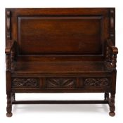 A 20TH CENTURY OAK MONK'S BENCH 119cm wide x 60cm deep x 102cm high with top up Condition: minor