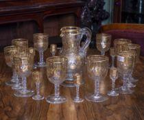 A SUITE OF MID 19TH CENTURY GILDED CUT GLASSWARE to include eleven wine glasses 8.5cm diameter x
