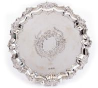 A SILVER SALVER by Walker & Hall with marks for Sheffield 1899, 22cm diameter, 345 grams