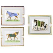 THREE HERMES PORCELAIN ASHTRAYS each decorated with horses, 19.5cm x 16cm Condition: the blue glazed