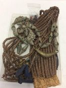 TWO AFRICAN BENIN BRONZED NECKLACES made with elongated beads together with a large Masai metal