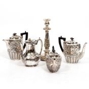 FOUR 19TH CENTURY SILVER PLATED TEAPOTS and a Victorian silver candlestick, the candlestick 32.5cm