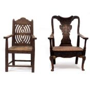 A CARVED OAK OPEN ARMCHAIR of large proportions with carved shaped eagle splat, turned supports,