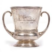 A TWIN HANDLED SILVER CUP engraved with 'Harry from his Godfather 2nd March 1907', marks for