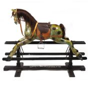 A LATE 19TH / EARLY 20TH CENTURY ROCKING HORSE the black painted frame marked 'Mr W.Bailey,