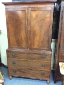 A 19TH CENTURY MAHOGANY LINEN PRESS with twin panelled doors opening to reveal converted hanging
