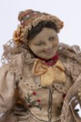 FOUR EARLY 20TH CENTURY CONTINENTAL DOLLS each with original clothing, approximately 34cm high