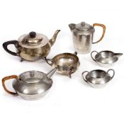 AN ARTS AND CRAFTS HAMMERED SILVER TEAPOT and matching sugar bowl by Northern Goldsmiths & Co