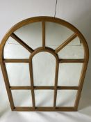 AN ARCHING WALNUT FRAMED WINDOW MIRROR with ten sections, 73cm x 105cm Condition: good condition