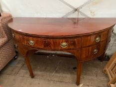 A GEORGE III MAHOGANY DEMI LUNE SIDE TABLE with a central drawer flanked by two deep drawers and