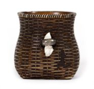 AN ANTIQUE JAPANESE NETSUKE in the form of a basket, with white metal clasp, 3.2cm high Condition: