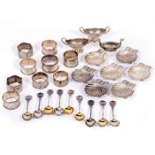 A SMALL QUANTITY OF WHITE METAL AND SILVER ITEMS to include silver napkin rings, scallop shaped