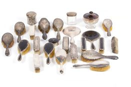 A LARGE QUANTITY OF SILVER DRESSING ITEMS to include silver brushes, silver pots, silver lidded