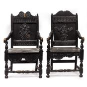 TWO ANTIQUE AND LATER EBONISED OAK WAINSCOTT STYLE ARMCHAIRS with carved panelled backs and turned