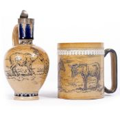 A DOULTON LAMBETH JUG by Hannah Barlow, having a silver top and decorated with goats, 10cm wide x