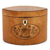 A GEORGE III SATINWOOD TEA CADDY of navette form with inlaid decoration, 15cm wide x 8.5cm deep x