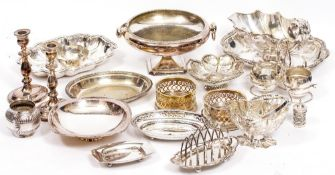 A LARGE COLLECTION OF SILVER PLATED WARES to include entree dishes, sauce boats, bowls, a pair of
