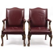 A PAIR OF RED LEATHER UPHOLSTERED OPEN ARMCHAIRS with cabriole legs and claw and ball feet, each