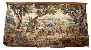 AN 18TH CENTURY STYLE MACHINE MADE TAPESTRY PANEL depicting a huntsman within a far reaching