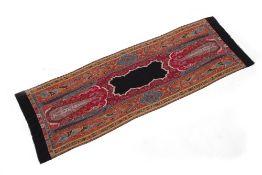 AN INDIAN PAISLEY STYLE WOOLLEN SHAWL with black bordered ends, 207cm long x 69cm wide Condition: