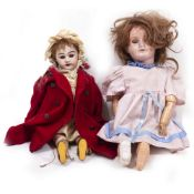 AN ANTIQUE UNMARKED BISQUE HEADED DOLL 47cm in length; a composite headed doll; two further dolls