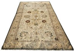 A LARGE CREAM GROUND FLORAL CARPET with multiple banded border in green edging, approximately 926