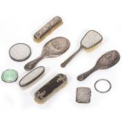 A SILVER BACKED DRESSING TABLE HAND MIRROR together with matching silver back for a hairbrush and