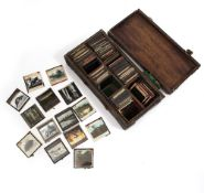 A COLLECTION OF APPROXIMATELY 150 LATE 19TH / EARLY 20TH CENTURY MAGIC LANTERN SLIDES to include