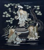 AN EMBROIDERED JAPANESE BLACK SILK PANEL depicting figures dancing around a cauldron beneath pine