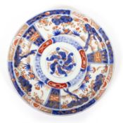 AN IMARI PORCELAIN DISH with three feet, 24.5cm diameter x 4cm high Condition: one foot has been