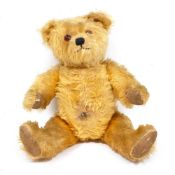 A MID 20TH CENTURY MUSICAL TEDDY BEAR 40cm in length Condition: some small tears to the pads, wear