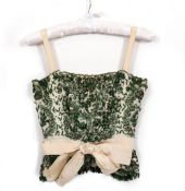 A CHRISTIAN DIOR OF LONDON LIMITED GREEN BEADED BONED TOP with zip back, the label numbered 29087