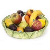 A COLLECTION OF PENKRIDGE CERAMIC FRUIT AND VEGETABLES to include a banana, pomegranate, apple,