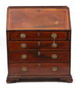 A GEORGE III MAHOGANY AND SATINWOOD CROSS BANDED BUREAU the fall front opening to reveal drawers and
