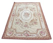 AN AUBUSSON NEEDLEPOINT CARPET with floral decoration, 144cm x 244cm Condition: moth damage to the