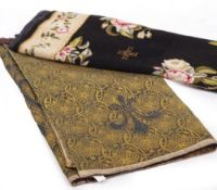A SMALL NEEDLEWORK CARPET OR RUG of black ground with floral sprays within a floral border, 170cm