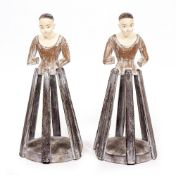 A PAIR OF MODERN PAINTED SANTOS DOLL MANNEQUINS on spreading slatted bases