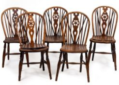 A MATCHED SET OF TEN 19TH CENTURY ASH AND ELM WHEEL BACKED KITCHEN CHAIRS to include two