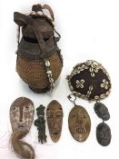 A KENYAN BORANA CALABASH CONTAINER woven cane work and leather decorated with cowrie shells, 32.
