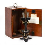 AN EARLY 20TH CENTURY BINOCULAR MICROSCOPE by C.Baker numbered 6452 in a fitted mahogany case