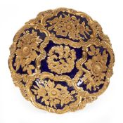 A MEISSEN PORCELAIN SERVING BOWL with a cobalt blue ground and raised gilded floral decoration
