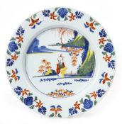 AN 18TH CENTURY LAMBETH DELFT CHARGER circa 1765-1775, attributed to Abigail Griffith, 34.5cm