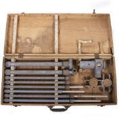 A MILITARY FIELD ANTENNA grey painted with screwed sections in a fitted beechwood case, the case