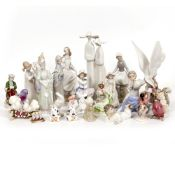 A COLLECTION OF PORCELAIN FIGURINES to include Lladro and Beatrix Potter Condition: the Lladro