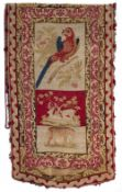 A VICTORIAN NEEDLEWORK BANNER depicting a parrot on a fruiting branch and with deer and a leopard