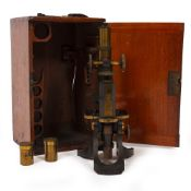 A LATE 19TH / EARLY 20TH CENTURY MICROSCOPE by Swift & Son of Tottenham Court Road, London, with