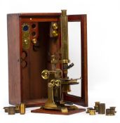 A LARGE LATE 19TH CENTURY UNSIGNED MICROSCOPE on a Ross pattern stand, with coarse and fine